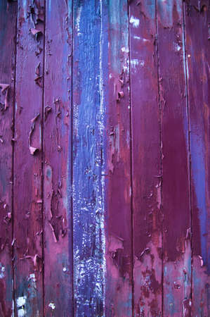 Flaking paint on wooden boards