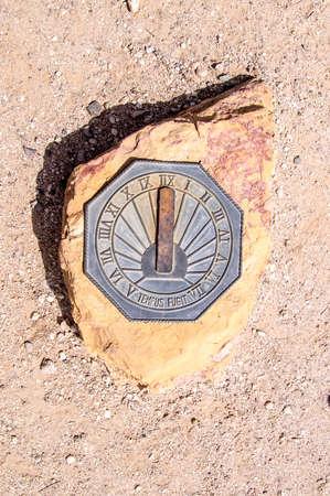 Metal Sun dial on rock in the Arizona desert Stock fotó