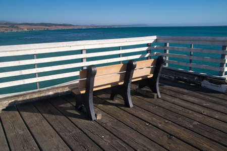 Bench on the pier of California coast Stock fotó
