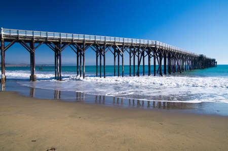 Long pier stands in the Pacific Ocean at California