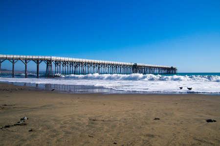 California coastal pier with tide coming in Stock fotó