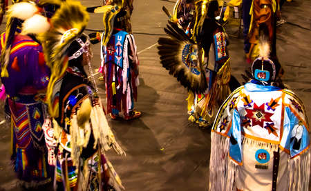 Pow wow dancers in full costume and in motion