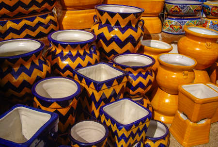 Colorful Mexican pots in outdoor market