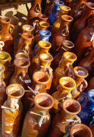 Orange and blue Mexican pots in outdoor public market