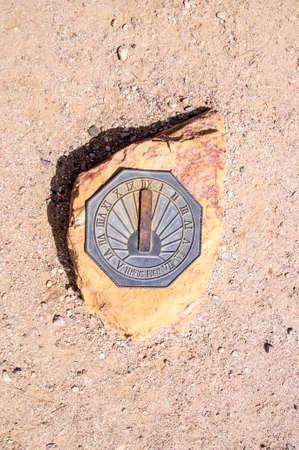 sun dial: Sun dial on rock in the Arizona desert