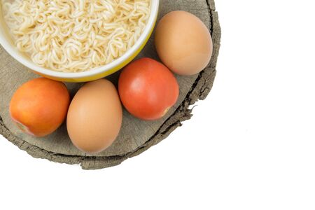 cooked instant noodle: Instant noodle and eggs isolated with path on wooden background