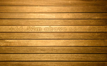 floor level: Wooden floor with text at sea level