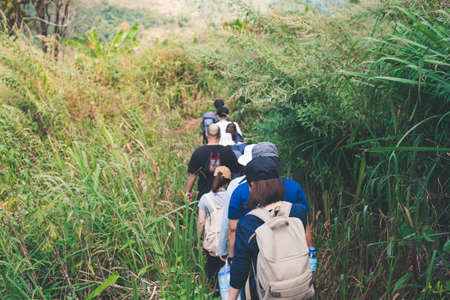 Group trekking in the rain forest, rocky mountain at Chiang Dao national park, Chiang Mai, Thailand