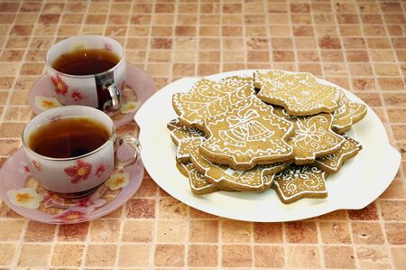 Two cups of tea and gingerbread cookies on the plate Stock Photo - 5889615