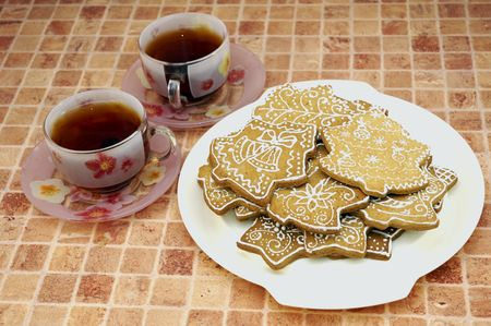 Two cups of tea and gingerbread cookies on the plate Stock Photo - 5889626