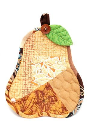 Textile potholder pear photographed over white background photo