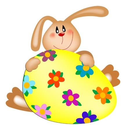 Conejo de Pascua con un huevo pintado Foto de archivo - 9124414