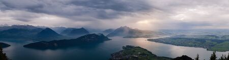 A storm is coming over the Quatre Cantons lake, seen from Mount Rigi Hochflue trail. Stock Photo