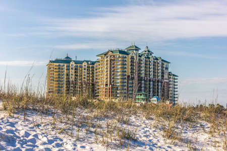 other side of: An afternoon shot of a beautiful condo on the other side of a sand dune