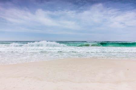 crashing: Waves crashing on the beautiful beach Stock Photo