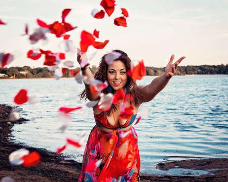 sexy latina: Woman Throws Rose Petals
