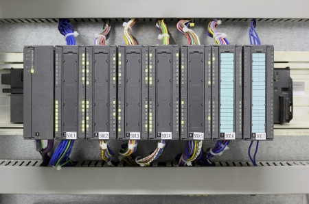 input output: Programmable logic controller in industry.
