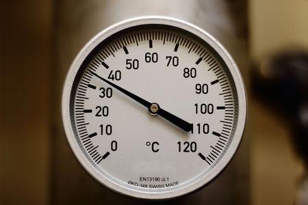 Temperature gauge in industrial process. Фото со стока