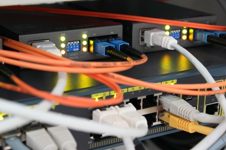 Optical and ethernet connections plugged. Stock Photo - 8362004