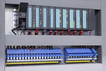 logic: Programmable logic controller and relays in industry Stock Photo