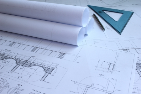 Blueprints, ruler and pencil on mechanical engineer's desk. Standard-Bild