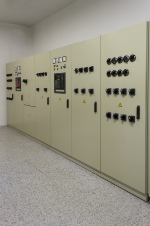 switchgear: Electrical energy distribution cubicles in a factory.