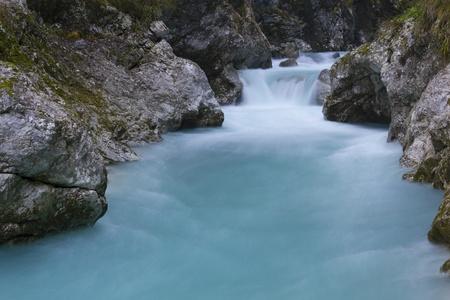 Long exposure of blue river stream (Tolminka river gorge, Soca valley, Slovenia).
