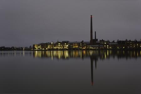 Industrial view by sea at night (Vaasa, Finland).