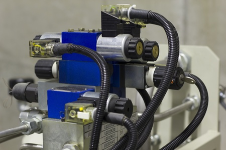 fluid: Electric solenoid valves to control hydraulics in industrial process.