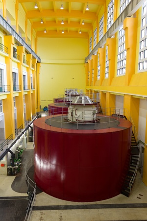 Electric generators in hydro power plant machine hall