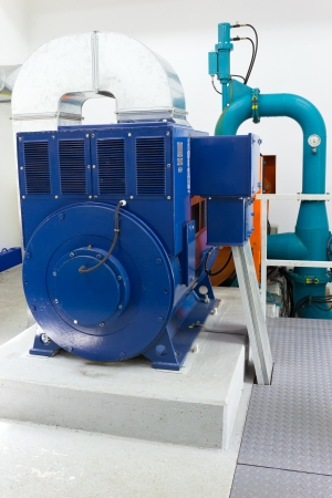 hydro power: Electric generator in a small hydro power plant