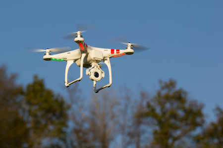 controlled: Radio controlled quadcopter used for aerial photography.