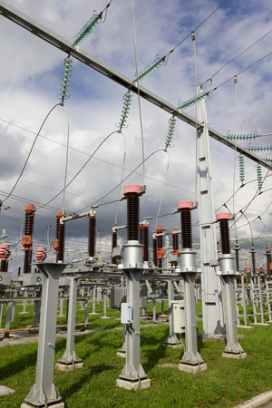 Electrical power substation with current measuring transformers in front.
