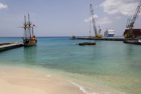 Harbour with pirate ship, cranes and cruise ship in the back, George Town, Grand Cayman, Cayman islands
