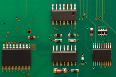 Macro image of circuit board with integrated chips. Archivio Fotografico