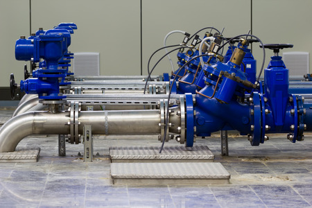 Water pumping station with booster pumps and valves.