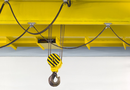 above head: Electrically driven heavy duty overhead crane in a factory.