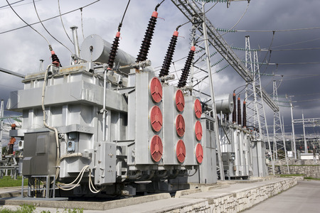 electrical cable: Electrical power transformers in high voltage substation.