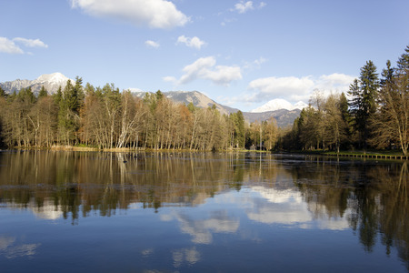 karawanks: Alpine lake reflection at Brdo near Kranj outdoor park, Slovenia Stock Photo