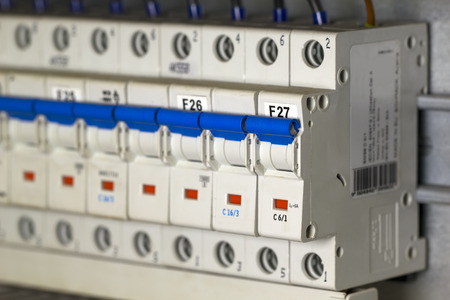 Automatic fuse switches mounted on a DIN rail. Archivio Fotografico