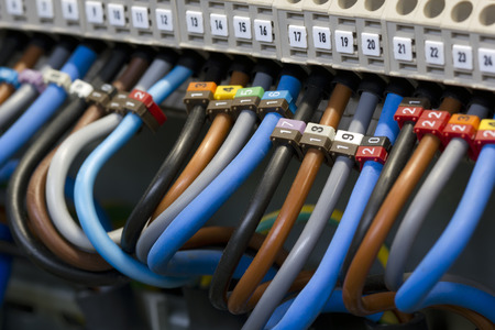electric wires: Close up of a three phase power supply electrical wiring and terminals. Stock Photo