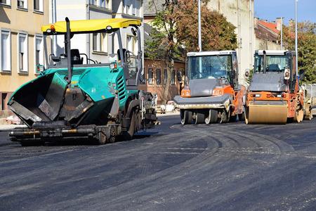 steamroller: Asphalt paving vehicle and road roller at the road construction