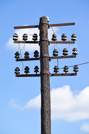 telephone pole: Old telephone pole on the street