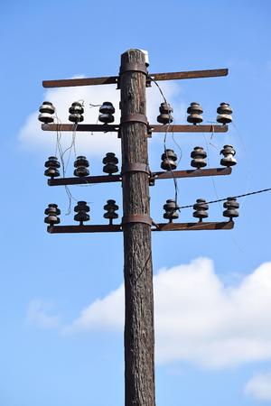 telephone pole: Old telephone pole on the street