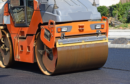 steam roller: Steam roller is working at the road construction Stock Photo