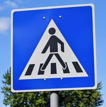 pedestrian crossing: Pedestrian crossing sign on the road Stock Photo
