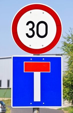 dead end: Speed limit and dead end traffic signs on the road