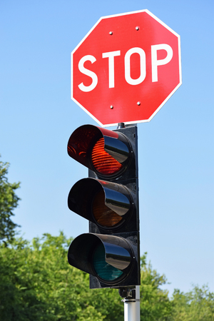 amber light: Stop sign and traffic lights at the road crossing