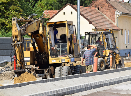 steam roller: Excavators at the road construction in the city Stock Photo