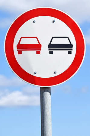 overtaking: No overtaking traffic sign on the road